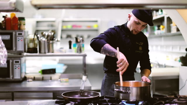 chef preparing food - busy restaurant kitchen stock videos & royalty-free footage