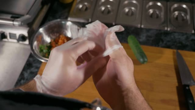 chef preparing for cook food in restaurant, he putting the latex gloves - igiene video stock e b–roll