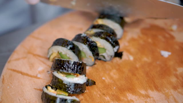 chef preparing korean traditional food kimbap like sushi at restaurant - rotolo video stock e b–roll