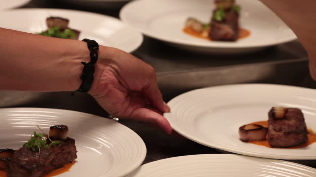 Chef preparing plates to be served video