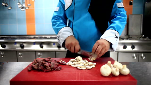 HD: Chef Preparing some Food in Kitchen video