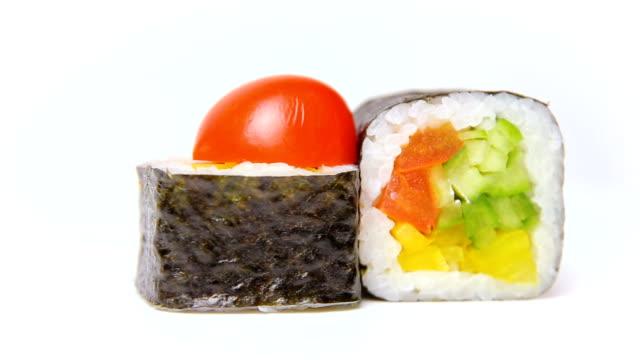chef presentation of japan restaurant rotation on white Noris Maki sushi rolls with vegetables video