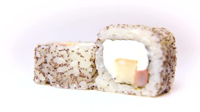 chef presentation sushi rolls with poppy seeds Nomi Maki rotating on white video