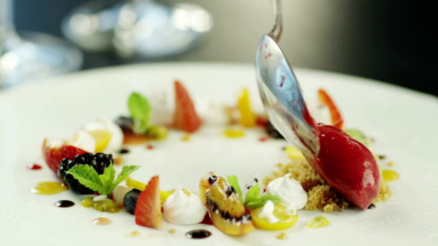 chef serving dessert with fruits, ice cream and crispy meringue. - fine dining stock videos and b-roll footage