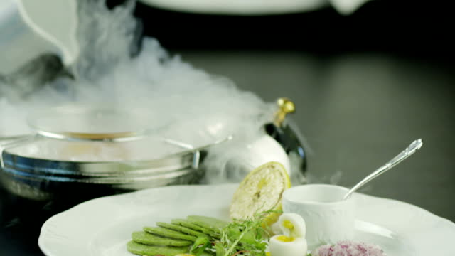 chef serving dish with fish fillet. close-up. - fine dining stock videos and b-roll footage