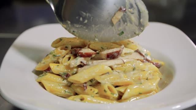 Chef serving pasta dish Chef serving pasta dish macaroni stock videos & royalty-free footage