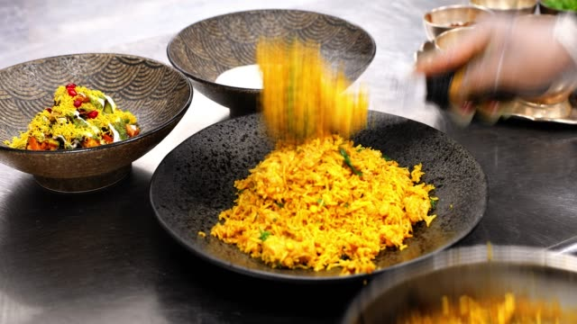 Chef Serving the Biryani Along with Other Condiments at an Indian Restaurant