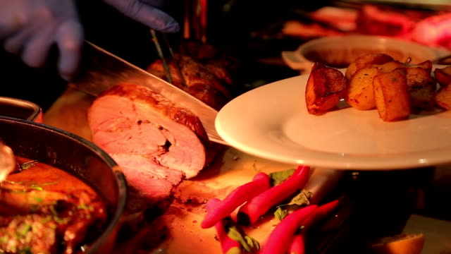 Chef Slices delicious meat and serving for client - Man is holiding the plate with appetizers video
