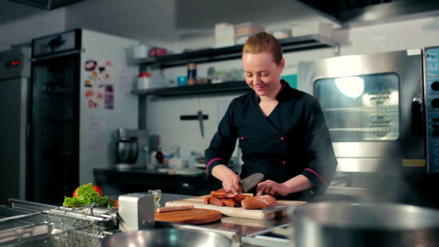 Chef slicing sausages on the cutting board video