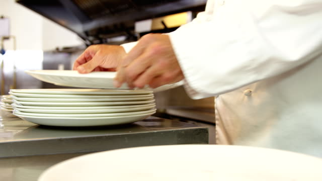 Chef tidying up the plates video