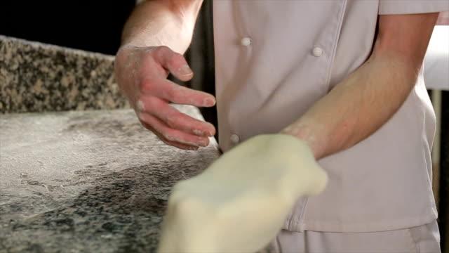Chef Tossing Pizza Dough. Skillful chef preparing a pizza video