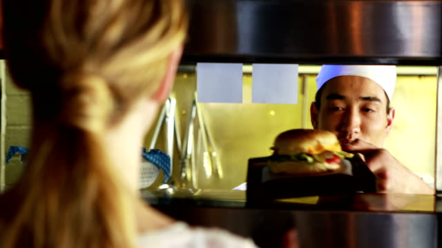 Chef working in a restaurant Chef placing order at the kitchen counter in a restaurant tray stock videos & royalty-free footage