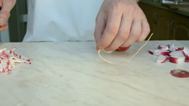 Chefs hands cutting a fresh radish. video