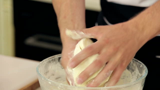 Chef's Hands Knead Dough at the Kitchen video