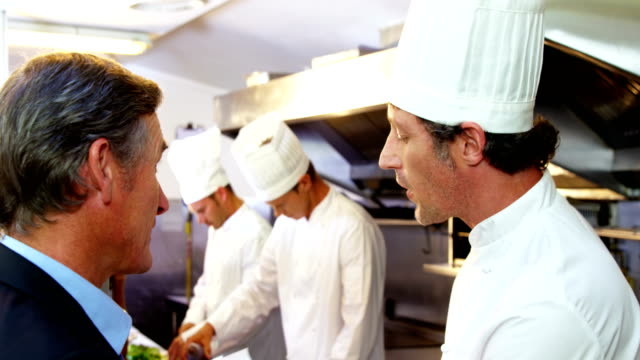 chefs talking - busy restaurant kitchen stock videos & royalty-free footage