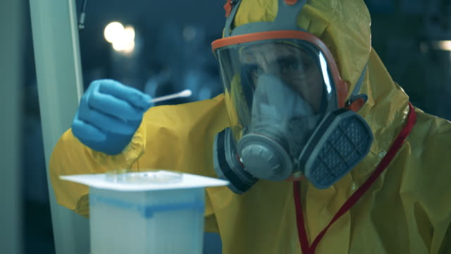 Chemical analysis is being done by an expert in a hazmat suit. Antibodies research cocnept, covid-19 coronavirus pandemic. Chemical analysis is being done by an expert in a hazmat suit. 4K legal trial stock videos & royalty-free footage