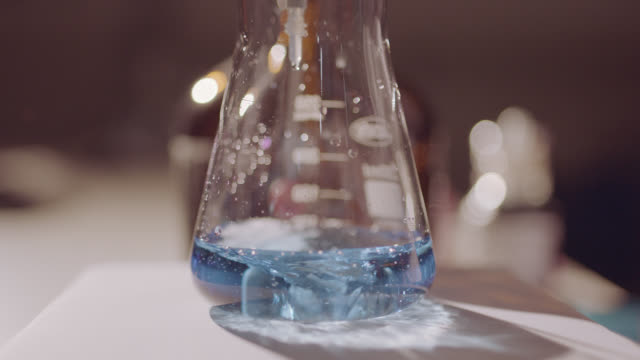 Chemical Reaction in Shaking Liquid Beaker Chemical reaction in shaking liquid beaker. Analytical equipment, laboratory shaker. beaker stock videos & royalty-free footage