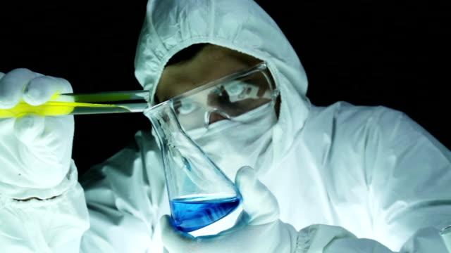 Chemical Scientist Mixing Liquids in Beaker video