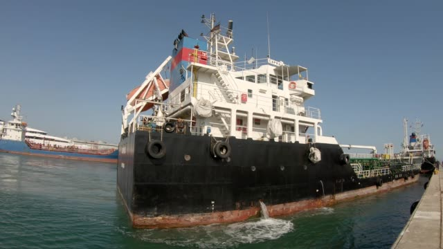 chemical ship mooring in the harbor - chiatta video stock e b–roll