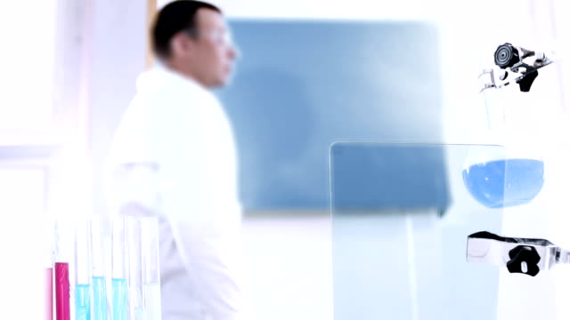 Chemist at Work In A Laboratory. video
