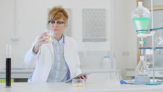 Chemist working with terpene CBD crystals and tablet in laboratory Female chemical scientist inspecting hemp terpenes crystal in laboratory. Large hemp terpsolate crystal are placed on watch glass in laboratory. Chemist holding tablet. cbd oil stock videos & royalty-free footage
