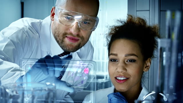 chemists in modern laboratory - bio tech stock videos and b-roll footage
