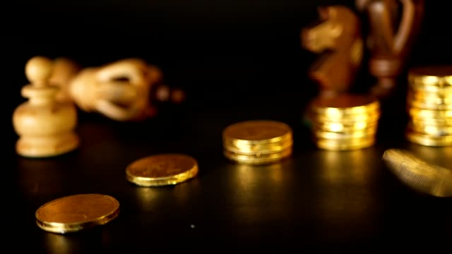 Chess and stack of coins in concept of money power or saving money, financial growth, strategy investment, retirement