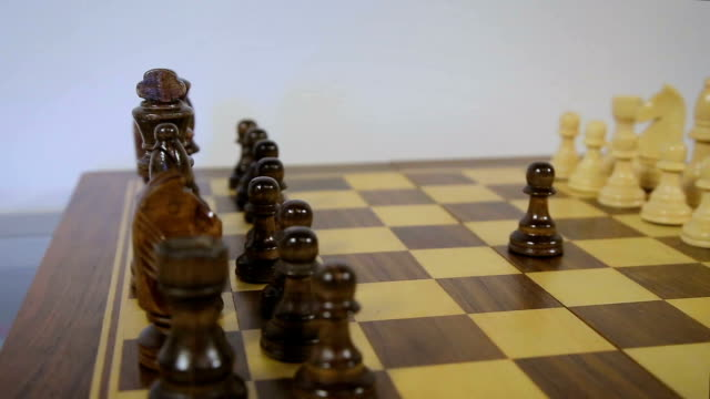 Chess game start. Black pawn opens party in chess, using the right of first move. Circular flight, dolly slider cam video
