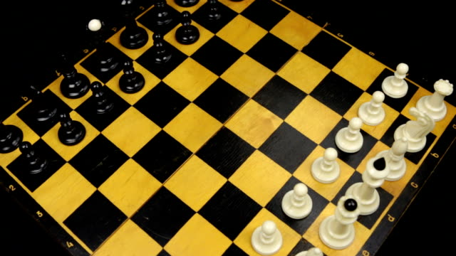Chess pieces on a chessboard table. Panorama.