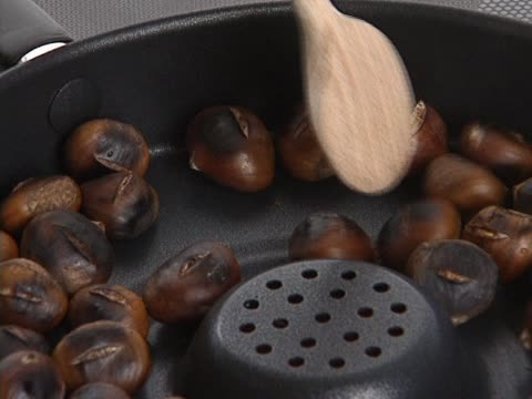 Chestnuts being backed in pan video