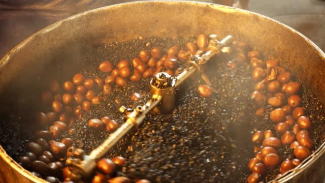 chestnuts roasting in a drum at chinatown in kuala lumpur - kuala lumpur video stock e b–roll