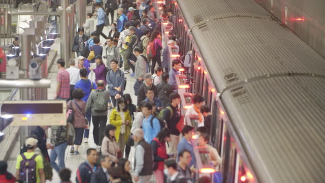 Chiang Kaishek subway station passengers 4K color video of passengers in Chiang Kaishek underground staion with metro train. subway train stock videos & royalty-free footage