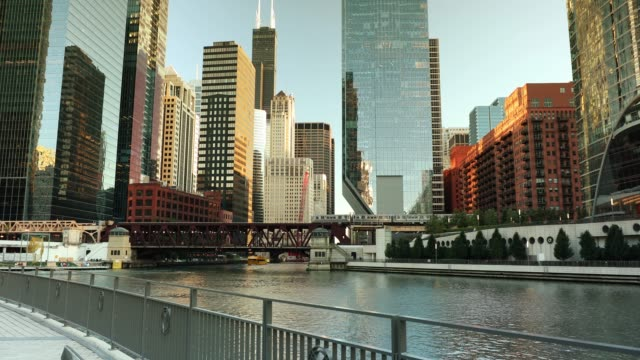 Chicago cityscape and ferry boats on the river City buildings and skyline over the boats on the Chicago River Illinois USA chicago stock videos & royalty-free footage