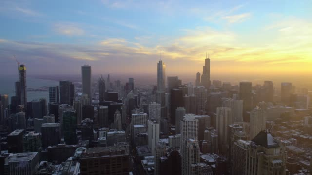 Chicago downtown area at sunset from skyscraper top