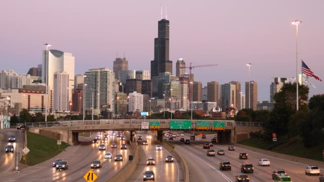 Chicago Illinois downtown city skyline view over the freeway Chicago cityscape looking out over the rush hour traffic commute of the highway in Illinois USA chicago stock videos & royalty-free footage
