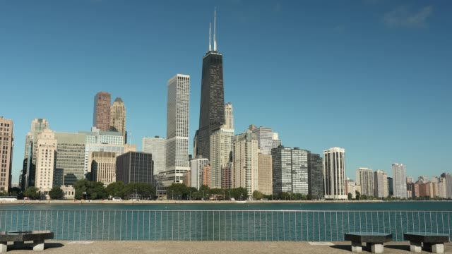 Chicago Illinois downtown skyline across Lake Michigan Chicago cityscape across Lake Michigan and Lake Shore Drive in Illinois USA chicago architecture stock videos & royalty-free footage