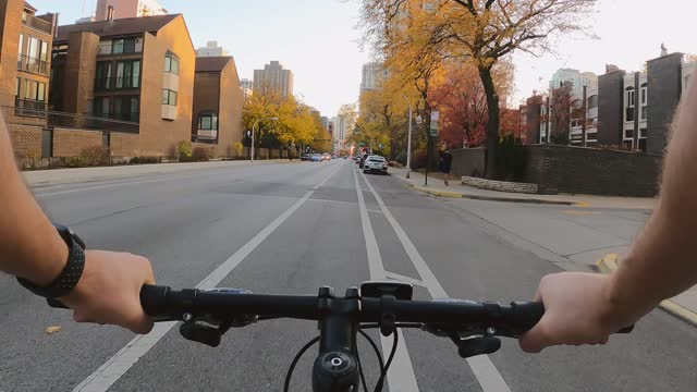 Chicago, Illinois: october 27, 2020 view from a guy riding through the city on a bike Chicago, Illinois: october 27, 2020 view from a guy riding through the city on a bike in the autumn handlebar stock videos & royalty-free footage