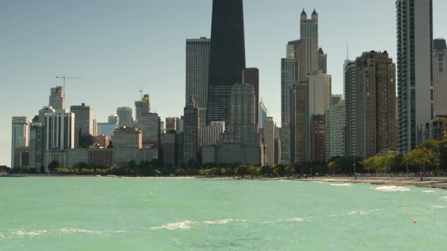 chicago illinois skyline across lake michigan - lakeshore stock videos & royalty-free footage