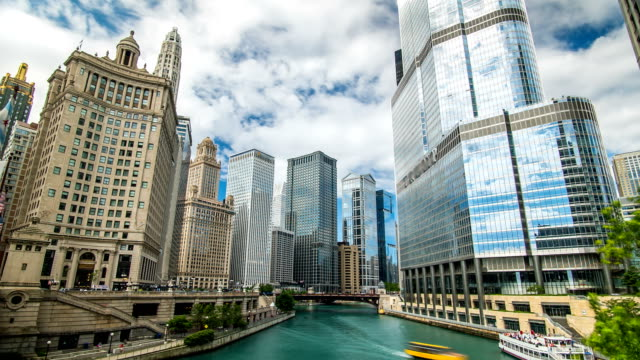 Chicago River Time Lapse Clouds 4K 1080P Time lapse of chicago river downtown with clouds and people moving in illinois with boats chicago stock videos & royalty-free footage