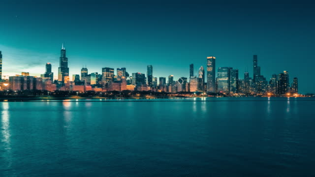 Chicago Skyline at Dusk Chicago Skyline at Dusk From Lake Michigan chicago stock videos & royalty-free footage