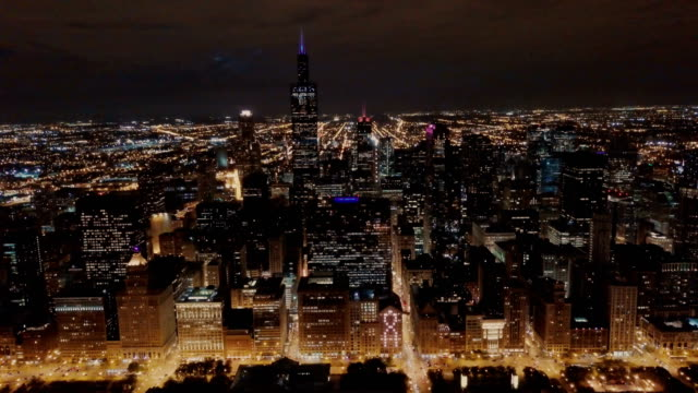 Chicago Skyline at Night - Aerial Aerial View of Downtown Chicago in 4k UHD chicago stock videos & royalty-free footage