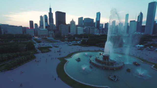 Chicago Skyline Buckingham Fountain Dusk Aerial Chicago Skyline Buckingham Fountain Dusk Aerial fountains stock videos & royalty-free footage