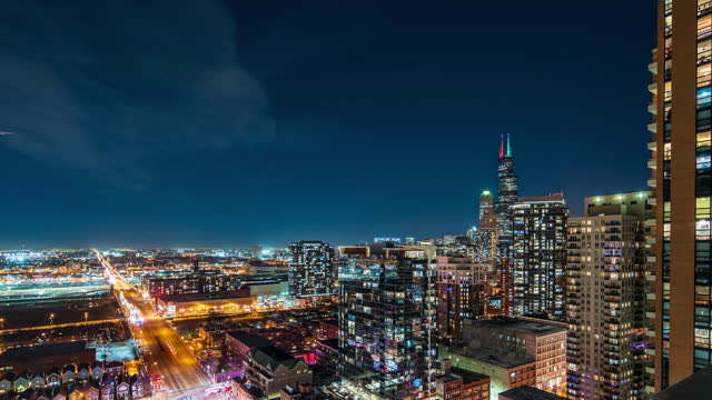 Chicago Skyline - Night Time Lapse - Aerial View