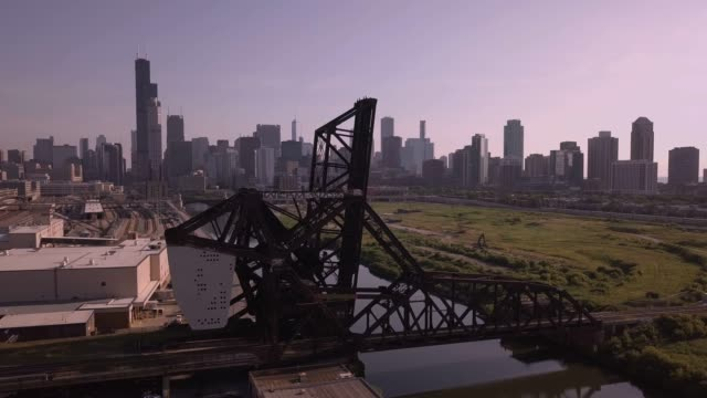 Chicago Skyline with Steel Bridge The Chicago skyline shot with a drone with a steel bridge in the foreground. south stock videos & royalty-free footage