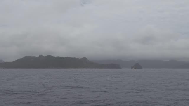 Chichi-Jima of Ogasawara Islands from passenger ship on rainy day