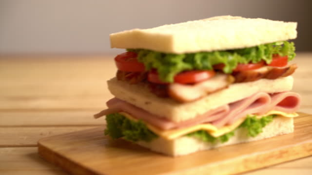 chiciken and ham sandwich on table video