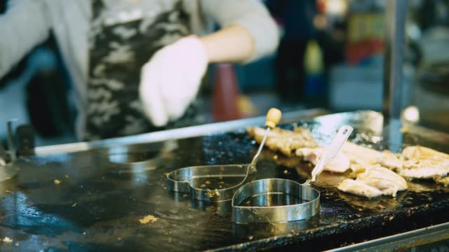 chicken dice cooking and flamed on bbq grill oven. Night market street food vendor in Taiwan video