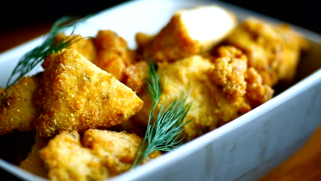 chicken fried in batter with dill - filetto video stock e b–roll