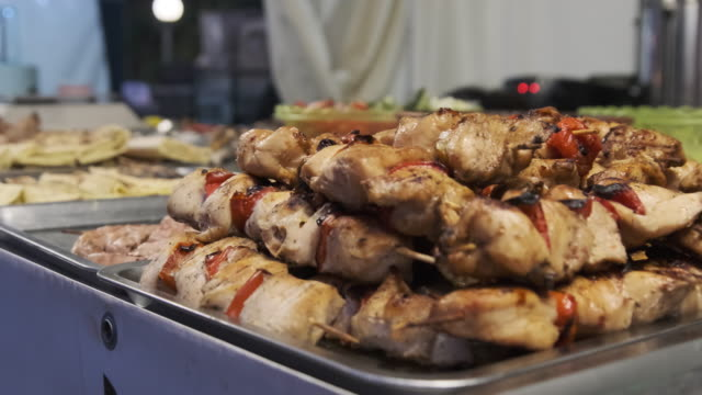 Chicken Kebab in a Street Shop Window Chicken Kebab in a Street Shop Window. Kebabs on skewers and baked vegetables on BBQ in showcase. Food court with variety of grilled ready meals at the festival. Ready-made food on Party skewer stock videos & royalty-free footage