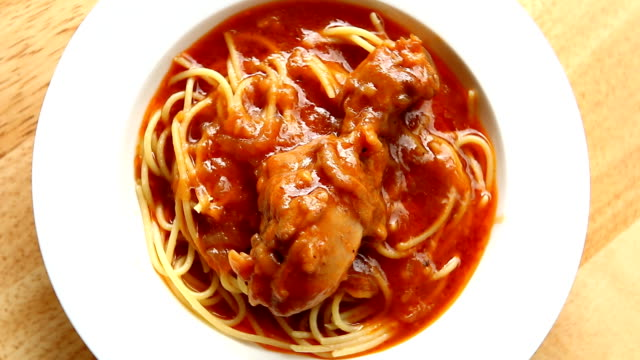 Chicken with  spaghetti in plate